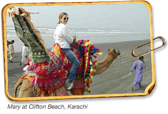 Mary McBride on a Camel in Karachi